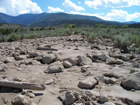 veiw from top of bridge showing creek filled with debris 100 yd upstream