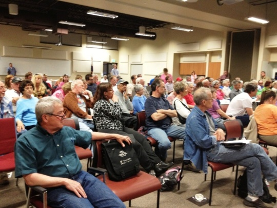 More than 100 citizens and members of the media attended the April 29 public meeting about the Parachute Creek spill