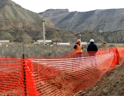 Workers near dilineation trenches at Parachute Creek spill site on March 19, 2013. [COGCC photo by David Andrews]