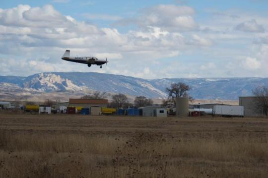 A research aircraft comes in for a landing in Vernal, Utah. Sensitive instruments aboard let CIRES and NOAA researchers measure atmospheric levels of methane and other chemicals during flights through Utah's Uintah Basin oil and gas fields. [Photo by Sonja Wolter, CIRES/NOAA]