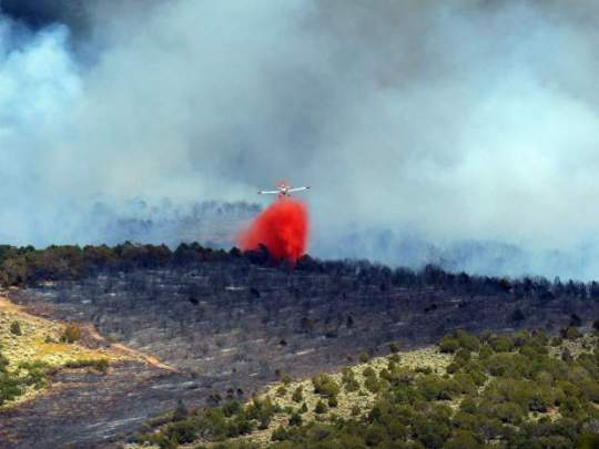 A single engine slurry bomber drops retardant on the Red Canyon Fire on Tuesday.  [photo credit: Frank Donofrio submitted to Post Independent]