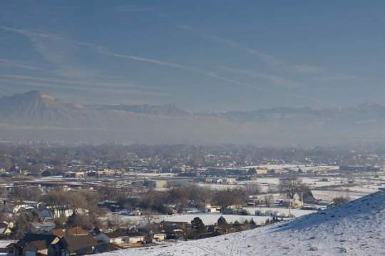 This photo was taken in the Grand Valley on Jan. 7, 2013, during a cold air inversion in which pollutants become trapped when a warmer air mass moves over cooler air. [Photo courtesy: Colo. Dept. of Public Health and Environment Air Pollution Control Division]