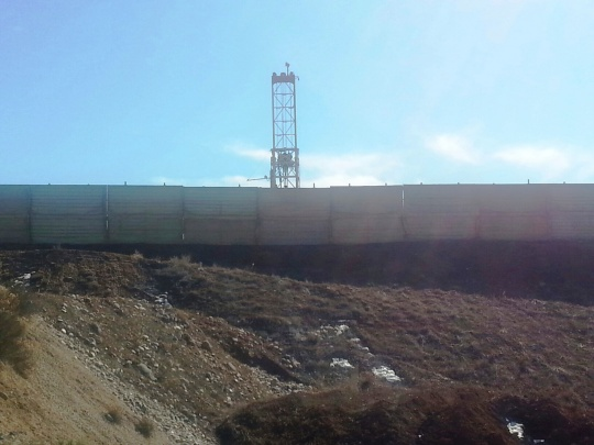 Sound wall at Frei A pad south of Coal Ridge High [Photo courtesy Ursa Resources]