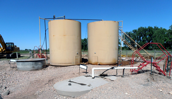 The area around these tanks showed evidence of massive spill [Photo credit Lee Buchsbaum & Noble Energy trashes Cache La Poudre | From the Styx by Peggy Tibbetts