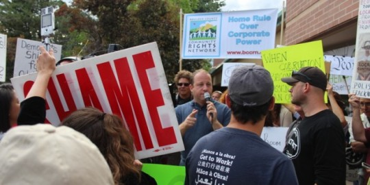 Over 100 people gathered at a town hall meeting held by Congressman Jared Polis, on August 6, 2014. Protesters were critical of the Congressman's August 4 deal with Governor John Hickenlooper to withdraw 2 ballot initiatives that he was backing that dealt with stricter oil and gas regulations.
