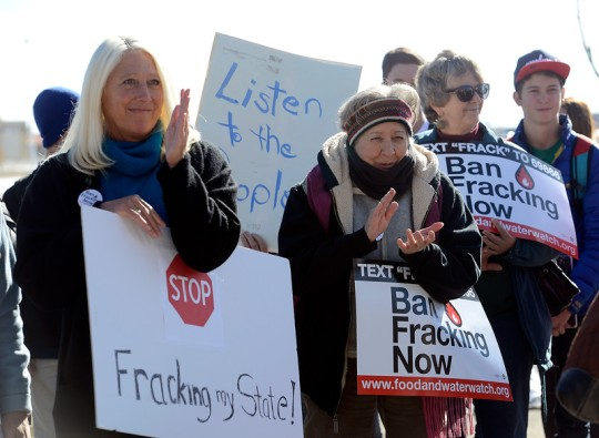 Tonya Trytten of Fort Collins, left, and Sharon Anhorn, right, of Loveland, participate in a rally Thursday, Nov. 20, 2014, before the Colorado Blue Ribbon Oil and Gas Task Force meeting at The Ranch in Loveland. (Photo by Jenny Sparks/Loveland Reporter-Herald) Click here to view photo gallery.