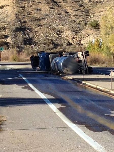 On October 28, 2014, this semi tanker truck roll-over closed the Hwy 6 & 13 Interchange in Rifle for several hours. The tanker was carrying 150 gallons of fracking wastewater. Homes and businesses in the area were evacuated – because well, everybody knows that frackwater is a toxic chemical soup. [Photo courtesy Rifle Police Dept]