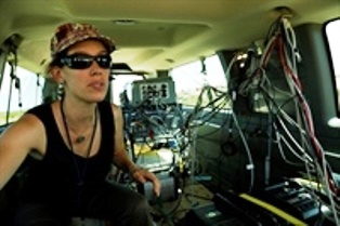 CIRES scientist Gabrielle Petron works from one of two mobile labs (vans outfitted with sophisticated chemical detection instruments) to probe the sources of methane emissions. [Photo courtesy: CIRES]