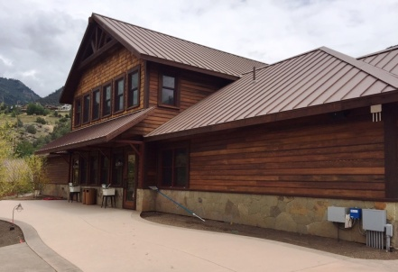 The lodge-style bathhouse contains the main entrance and gift shop plus men's, women's & family locker rooms.