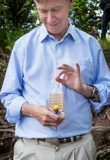 Gov. John Hickenlooper drops purification tablets into a bottle filled with Animas River water to kill any giardia. Shaun Stanley/Durango Herald