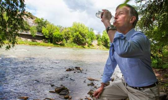 Gov. John Hickenlooper drinks water straight from the Animas River on Tuesday when he was in Durango to get an update about the blowout from Gold King Mine. The water was treated with an iodine tablet before he drank it, to kill any giardia. Shaun Stanley/Durango Herald