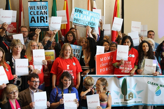 Activists and citizens pose for a photo shortly after a press conference in Dallas, Texas, at one of three national hearings on the Environmental Protection Agency's proposed rules to reduce fugitive methane emissions from new oil and gas facilities, September 23, 2015. (Photo: Candice Bernd)