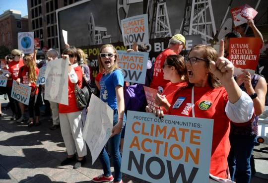DENVER,CO - September 23: Protestors rally along Wynkoop St. near 16th Ave on their way to the nearby Environmental Protection Agency offices September 23, 2015. The EPA was holding public meetings on proposed methane level cuts in the oil and gas industry. Photo by Andy Cross/The Denver Post