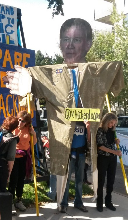 With Hickenlooper effigy at governor's mansion