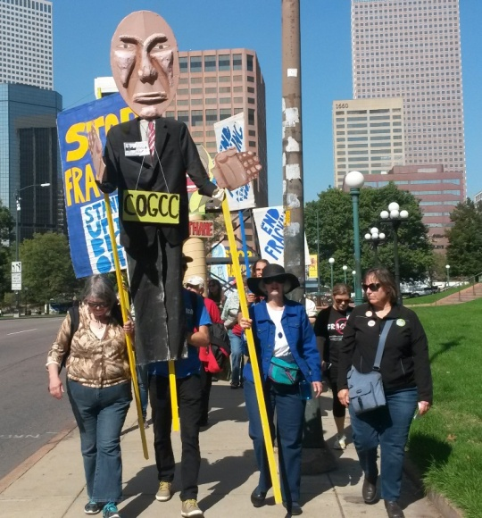 "On the march with COGCC effigy ""Matt Lepore"""