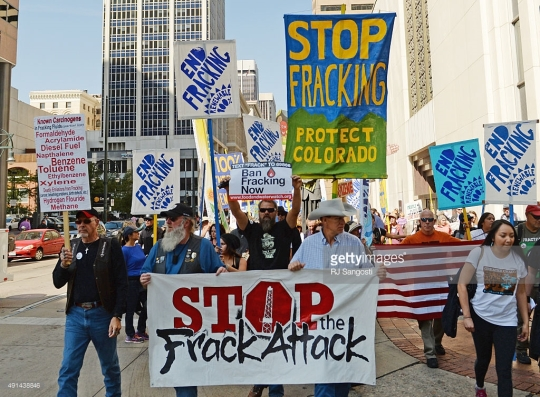 DENVER, CO - OCTOBER 05: Anti fracking protesters take to the streets in downtown Denver, October 05, 2015. Several hundred protesters marched down 17th Street to the State Capitol. (Photo by RJ Sangosti/The Denver Post)