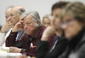 Jim Fitzgerald, center listens during an oil & gas task force debate last February. [David Zalubowski, The Associated Press]