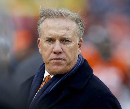 Denver Broncos Executive Vice President of Football Operations and General Manager, John Elway, watches his players prior to an NFL divisional playoff football game against the Indianapolis Colts, Sunday, Jan. 11, 2015, in Denver. [AP Photo/David Zalubowski]