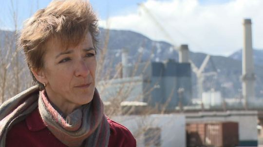 Leslie Weise talks with reporter outside the Martin Drake coal-fired power plant in Colorado Springs, March 17,2016 [Photo courtesy KUSA/9NEWS]