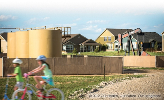 A well and battery of natural gas storage tanks near homes in Longmont, CO. [Photo courtesy: Our Health, Our Future, Our Longmont]