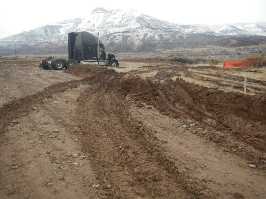 Ursa D Pad-January 12, 2017: Loose earthen edging along access road at entrance to well pad site has been breached by heavy equipment which rutted and compacted the area that had not been scraped. [COGCC photo]